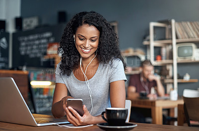 Buy stock photo Shot of a woman using her cellphone and laptop in a cafe
