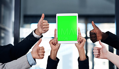 Buy stock photo Cropped shot of a group of businesspeople giving thumbs up and holding a digital tablet in a modern office