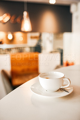 Buy stock photo Cropped shot of a freshly brewed cappuccino on the tabletop in an empty coffee shop