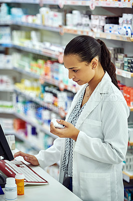 Buy stock photo Cropped shot of a female pharmacist working in a chemist