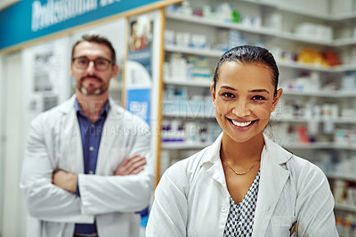 Buy stock photo Cropped shot of two pharmacists standing in a chemist