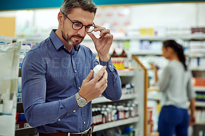 Buy stock photo Cropped shot of a customer looking at a product in a chemist
