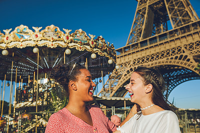 Buy stock photo Shot of two happy young women enjoying a day at the carnival