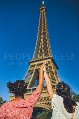 Buy stock photo Rearview shot of two enthusiastic young women admiring The Eiffel Tower at a carnival