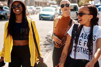 Buy stock photo Shot of three close friends spending the day together in the city