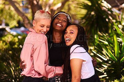 Buy stock photo Shot of a group of three attractive young women having fun and enjoying themselves outdoors