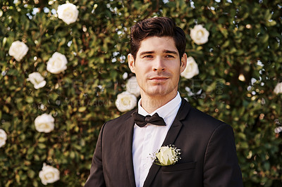 Buy stock photo Cropped portrait of a handsome young bridegroom looking thoughtful while standing outdoors on his wedding day
