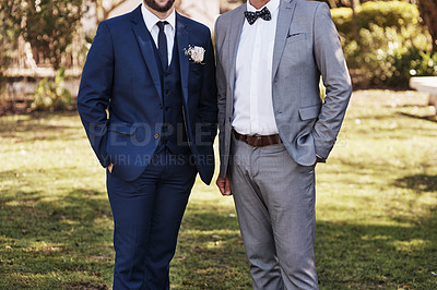 Buy stock photo Cropped shot of an unrecognizable bridegroom standing outdoors with father on his wedding day
