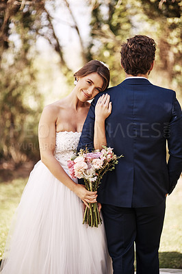 Buy stock photo Cropped shot of an affectionate young bride smiling while leaning on her groom's shoulder on their wedding day