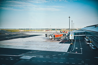 Buy stock photo Cropped shot of jet bridges on an empty tarmac at an international airport during the day