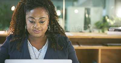 Buy stock photo Cropped shot of an attractive young businesswoman using a laptop while working in her office