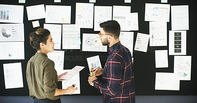 Buy stock photo Cropped shot of  an attractive young businesswoman using a digital tablet while brainstorming on a board  with her male colleague in a modern office