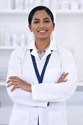 Buy stock photo Cropped portrait of an attractive young female scientist standing with her arms folded in the lab