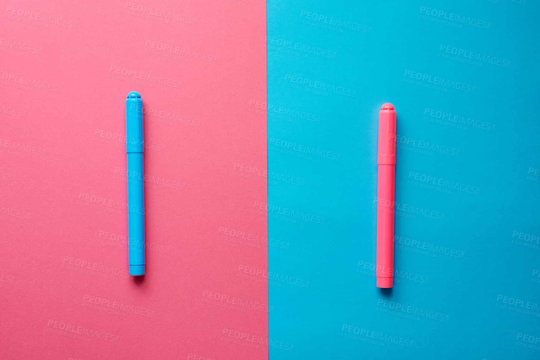 Buy stock photo Studio shot of two marker pens placed on two different coloured backgrounds adjacent to each other
