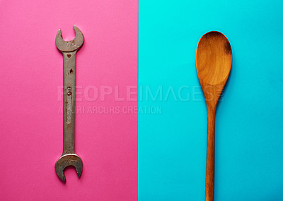 Buy stock photo Studio shot of an open-ended spanner and a wooden spoon placed on two different coloured backgrounds adjacent to each other