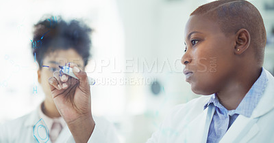 Buy stock photo Cropped shot of an attractive young female scientist writing on a glass wall while working with her colleague in a laboratory