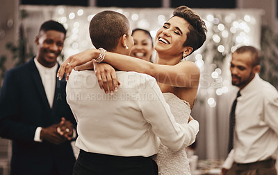Buy stock photo Shot of a newlywed couple dancing while being surrounded by their guests