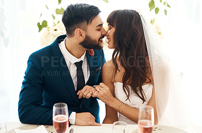 Buy stock photo Cropped shot of a newlywed couple sitting together at their wedding reception