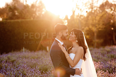 Buy stock photo Shot of a young couple standing together on their wedding day