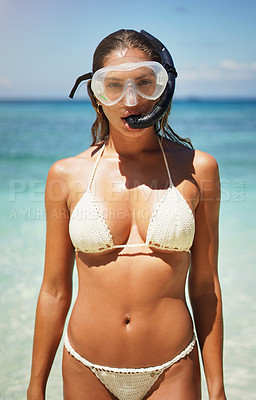 Buy stock photo Cropped portrait of an attractive young woman in scuba gear on the beach