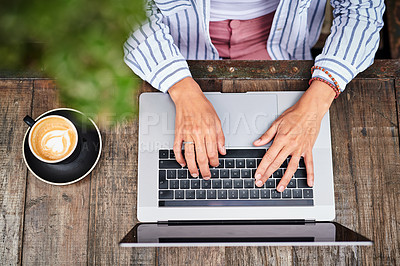 Buy stock photo Cropped shot of an unrecognizable woman using a smartphone and laptop at a restaurant