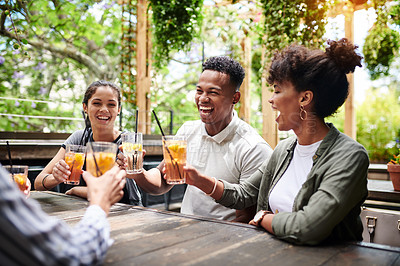 Buy stock photo Shot of a group of young friends toasting with their drinks at a restaurant