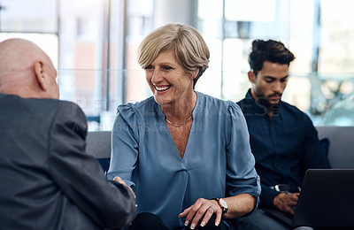 Buy stock photo Shot of an attractive mature businesswoman shaking hands with a client at work