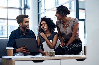 Buy stock photo Shot of a group of young businesspeople planning and discussing ideas together in the lounge area at work