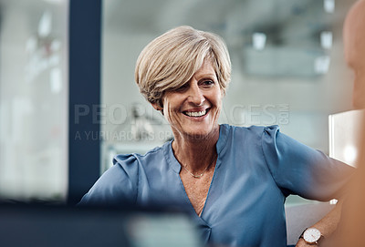 Buy stock photo Shot of an attractive mature businesswoman feeling confident and cheerful at work