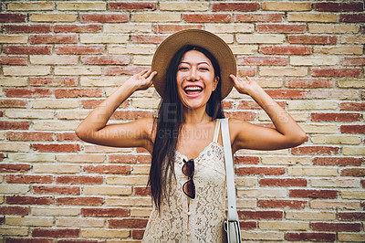 Buy stock photo Full length shot of an attractive young woman standing and feeling playful during a vacation in Spain