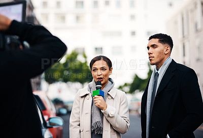 Buy stock photo Shot of an attractive young journalist interviewing a businessman outdoors in the city