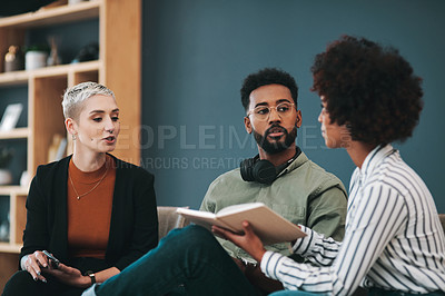 Buy stock photo Shot of young businesspeople having a conversation while sitting in the office