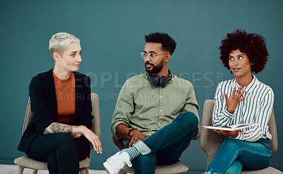 Buy stock photo Shot of young businesspeople sitting in line while waiting for their interviews