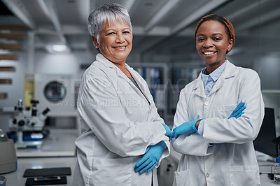 Buy stock photo Cropped portrait of two cheerful female scientists standing together in a laboratory