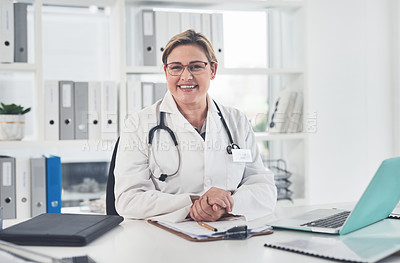 Buy stock photo Cropped portrait of an attractive young female doctor smiling while sitting in her office