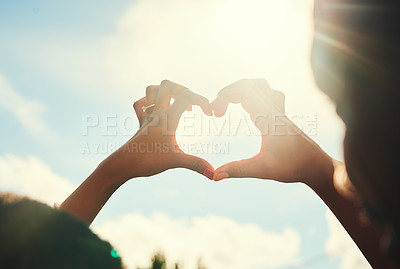 Buy stock photo Cropped shot of an unrecognizable couple forming a heart shape with their hands