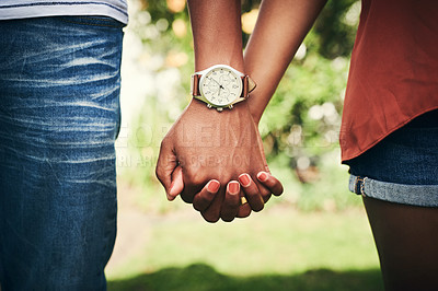 Buy stock photo Cropped shot of an unrecognizable couple standing hand in hand outside
