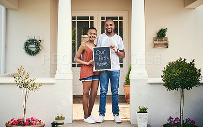 Buy stock photo Portrait of a young couple holding a chalkboard with