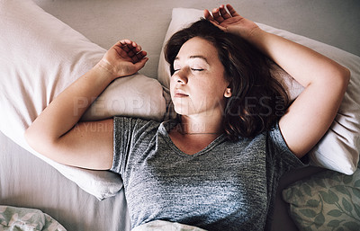 Buy stock photo High angle shot of an attractive young woman sleeping on her bed in the morning at home