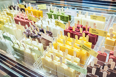 Buy stock photo Shot of an assortment of popsicles in a display stand at an ice cream parlour