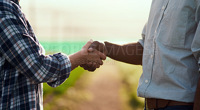 Buy stock photo Cropped shot of two unrecognizable farmers shaking hands while working on their farm