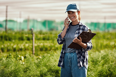Buy stock photo Cropped shot of an attractive young female farmer making a phonecall while working on her farm