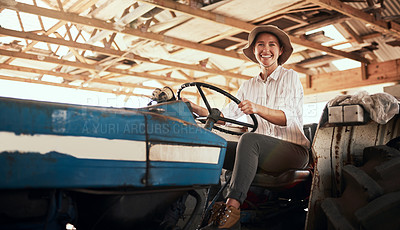 Buy stock photo Portrait of an attractive young female farmer posing while siting inside a tractor at her farm