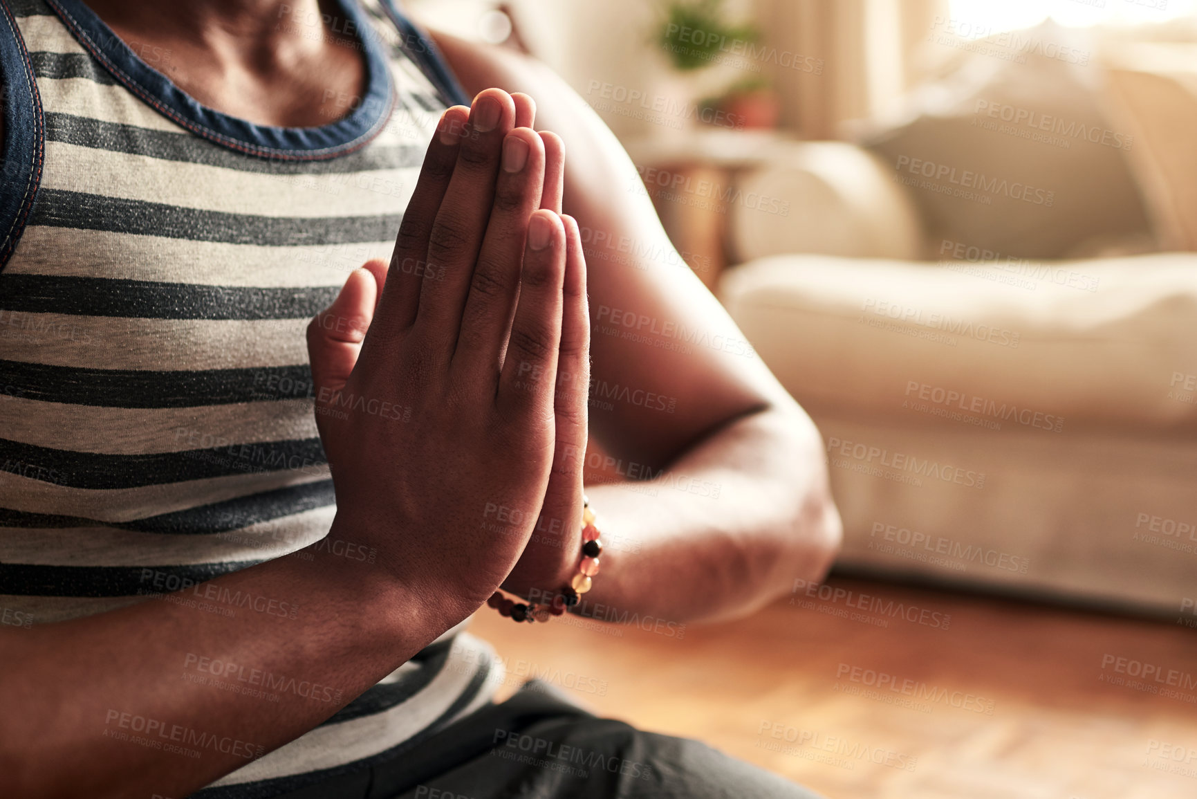 Buy stock photo Shot of a young man practising yoga at home during the day