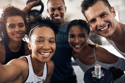 Buy stock photo Shot of a group of young people taking a selfie together during their workout in a gym
