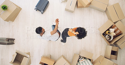 Buy stock photo High angle shot of a young couple having fun while moving house
