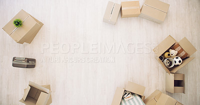 Buy stock photo High angle shot of boxes in an empty room in a house on moving day