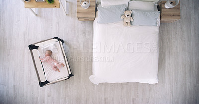 Buy stock photo High angle shot of an adorable baby girl lying down in a crib at home