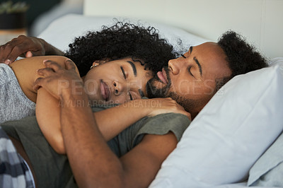Buy stock photo Cropped shot of a young couple sleeping together in their bed at home