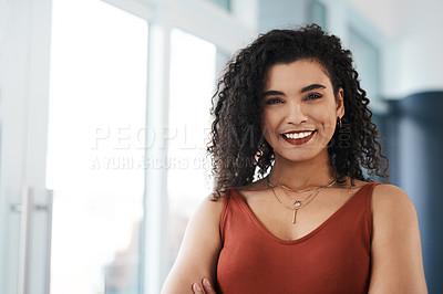 Buy stock photo Cropped portrait of an attractive young businesswoman standing alone in her office during the day